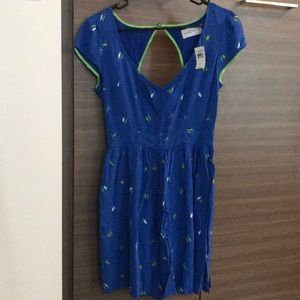 Backless blue dress with green and white birds